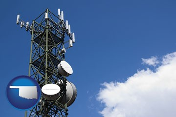 a telecommunications tower, with blue sky background - with Oklahoma icon